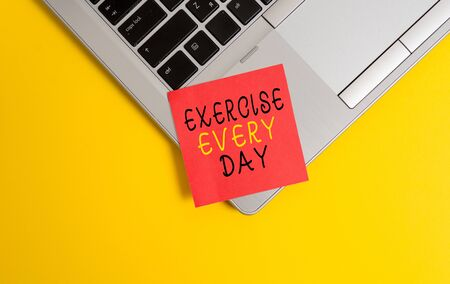 Writing note showing Exercise Every Day. Business concept for move body energetically in order to get fit and healthy Metallic trendy laptop blank sticky note empty text colored background