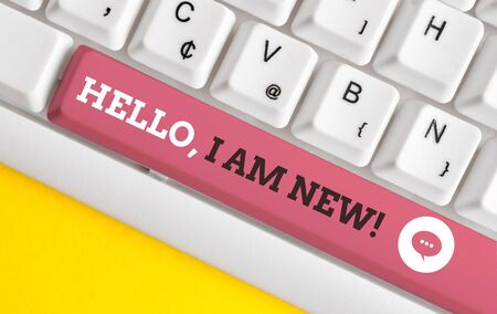 Writing note showing Hello I Am New. Business concept for introducing oneself in a group as fresh worker or student White pc keyboard with note paper above the white background