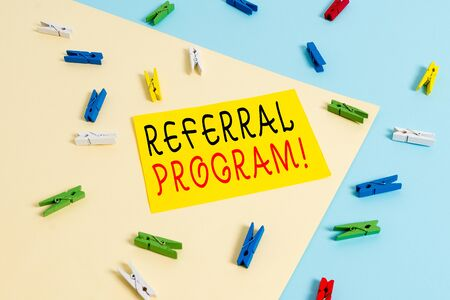 Text sign showing Referral Program. Business photo text internal recruitment method employed by organizations Colored clothespin paper empty reminder yellow blue floor background office