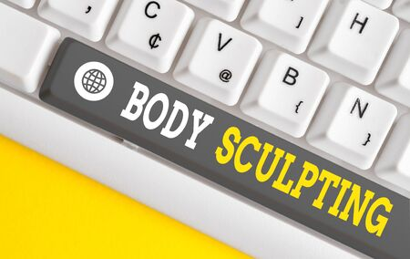 Writing note showing Body Sculpting. Business concept for activity of increasing the body s is visible muscle tone White pc keyboard with note paper above the white background 版權商用圖片