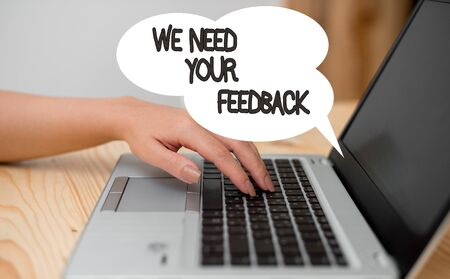 Writing note showing We Need Your Feedback. Business concept for criticism given to say can be done improvement woman with laptop smartphone and office supplies technology
