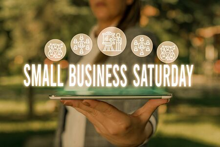 Handwriting text Small Business Saturday. Conceptual photo American shopping holiday held during the Saturday Woman wear formal work suit presenting presentation using smart device