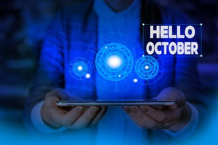 Handwriting text writing Hello October. Conceptual photo Last Quarter Tenth Month 30days Season Greeting Woman wear formal work suit presenting presentation using smart device