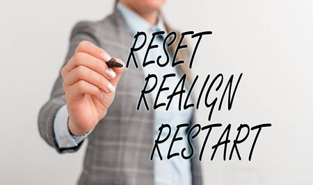 Conceptual hand writing showing Reset Realign Restart. Concept meaning Life audit will help you put things in perspectives Business woman pointing in empty space with pen