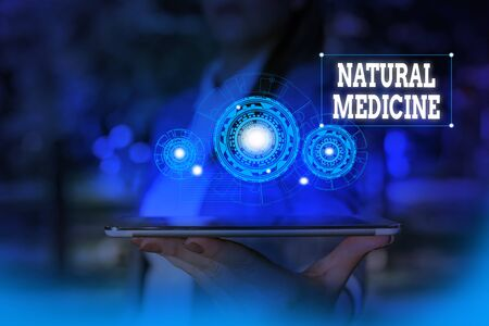 Text sign showing Natural Medicine. Business photo text any of various systems of healing or treating disease Woman wear formal work suit presenting presentation using smart device Stock fotó