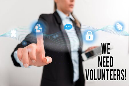 Text sign showing We Need Volunteers. Business photo text someone who does work without being paid for it Female human wear formal work suit presenting presentation use smart device