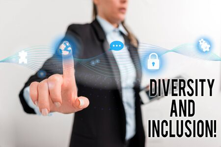 Text sign showing Diversity And Inclusion. Business photo text range huanalysis difference includes race ethnicity gender Female human wear formal work suit presenting presentation use smart device