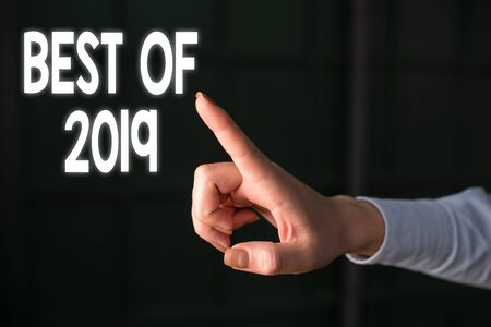 Writing note showing Best Of 2019. Business concept for great and marvelous things and events happened on 2019 Finger pointing in the Dark with hand pointing in the copy space