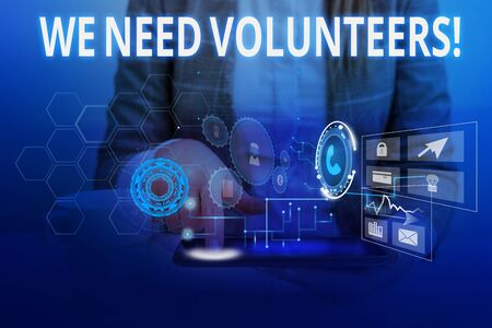 Word writing text We Need Volunteers. Business photo showcasing someone who does work without being paid for it Woman wear formal work suit presenting presentation using smart device