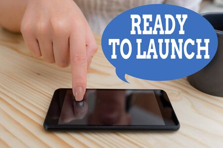 Text sign showing Ready To Launch. Business photo text an event to celebrate or introduce something new to market woman using smartphone office supplies technological devices inside home