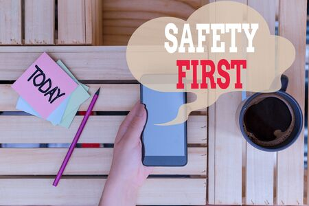 Text sign showing Safety First. Business photo text used to say that the most important thing is to be safe woman computer smartphone drink mug office supplies technological devices
