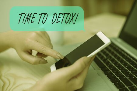 Conceptual hand writing showing Time To Detox. Concept meaning when you purify your body of toxins or stop consuming drug woman with laptop smartphone and office supplies technology