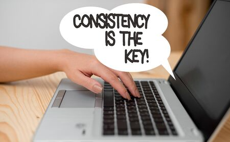 Writing note showing Consistency Is The Key. Business concept for by Breaking Bad Habits and Forming Good Ones woman with laptop smartphone and office supplies technology