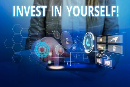 Word writing text Invest In Yourself. Business photo showcasing learn new things or materials thus making your lot better Woman wear formal work suit presenting presentation using smart device Banco de Imagens