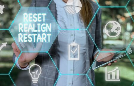 Handwriting text writing Reset Realign Restart. Conceptual photo Life audit will help you put things in perspectives Female human wear formal work suit presenting presentation use smart device Banco de Imagens