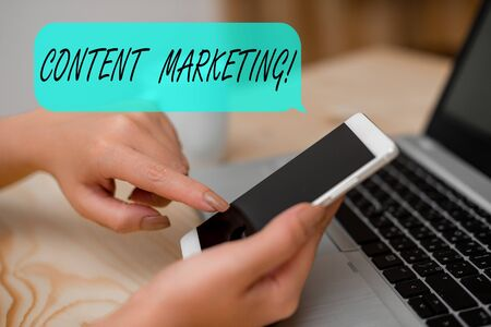 Conceptual hand writing showing Content Marketing. Concept meaning involves creation and sharing of online material woman with laptop smartphone and office supplies technology
