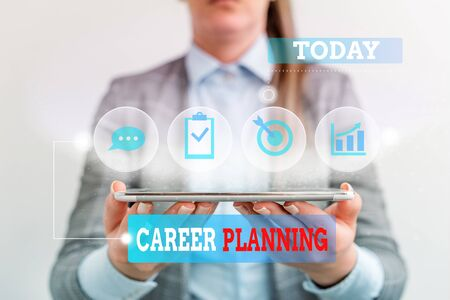Handwriting text writing Career Planning. Conceptual photo Strategically plan your career goals and work success Female human wear formal work suit presenting presentation use smart device Banco de Imagens