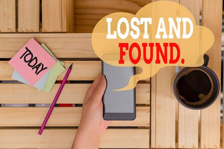 Text sign showing Lost And Found. Business photo text a place where lost items are stored until they reclaimed woman computer smartphone drink mug office supplies technological devices