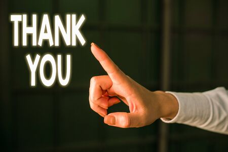 Writing note showing Thank You. Business concept for a polite expression used when acknowledging a gift or service Finger pointing in the Dark with hand pointing in the copy space