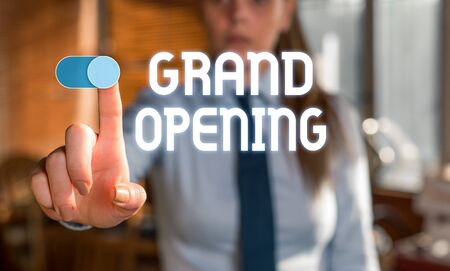 Text sign showing Grand Opening. Business photo showcasing Ribbon Cutting New Business First Official Day Launching Blurred woman in the background pointing with finger in empty space