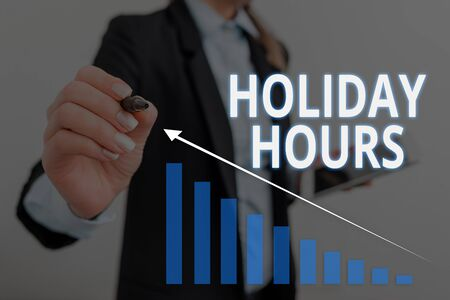 Text sign showing Holiday Hours. Business photo text employee receives twice their normal pay for all hours Woman wear formal work suit presenting presentation using smart device 写真素材