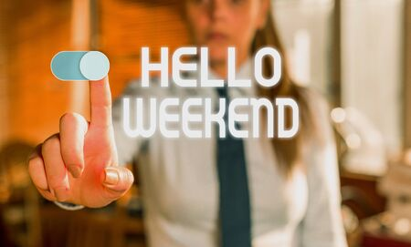 Text sign showing Hello Weekend. Business photo showcasing Getaway Adventure Friday Positivity Relaxation Invitation Blurred woman in the background pointing with finger in empty space