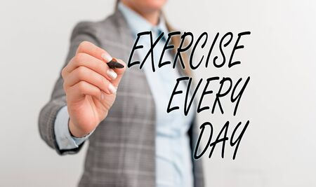Conceptual hand writing showing Exercise Every Day. Concept meaning move body energetically in order to get fit and healthy Business woman pointing in empty space with pen
