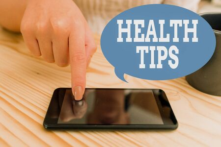 Text sign showing Health Tips. Business photo text advice or information given to be helpful in being healthy woman using smartphone office supplies technological devices inside home