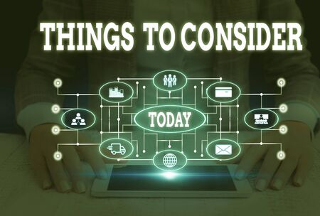 Writing note showing Things To Consider. Business concept for think about carefully especially in making decisions Woman wear formal work suit presenting presentation using smart device