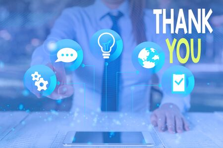 Conceptual hand writing showing Thank You. Concept meaning a polite expression used when acknowledging a gift or service Female human wear formal work suit presenting smart device