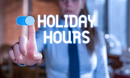 Text sign showing Holiday Hours. Business photo showcasing Schedule 24 or7 Half Day Today Last Minute Late Closing Blurred woman in the background pointing with finger in empty space 写真素材