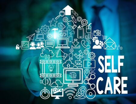 Text sign showing Self Care. Business photo text the practice of taking action to improve one s is own health Woman wear formal work suit presenting presentation using smart device