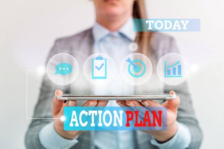 Handwriting text writing Action Plan. Conceptual photo detailed plan outlining actions needed to reach goals or vision Female human wear formal work suit presenting presentation use smart device