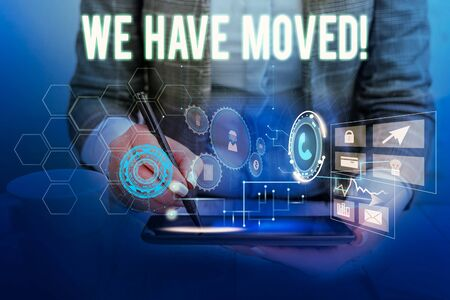Text sign showing We Have Moved. Business photo showcasing To go from one residence or location to another Relocate Woman wear formal work suit presenting presentation using smart device Zdjęcie Seryjne