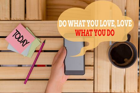 Text sign showing Do What You Love Love What You Do. Business photo text Pursue your dreams or passions in life woman computer smartphone drink mug office supplies technological devices