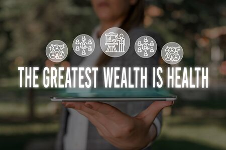 Handwriting text The Greatest Wealth Is Health. Conceptual photo Many sacrifice their money just to be healthy Woman wear formal work suit presenting presentation using smart device