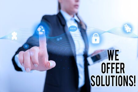 Text sign showing We Offer Solutions. Business photo text way to solve problem or deal with difficult situation Female human wear formal work suit presenting presentation use smart device Фото со стока