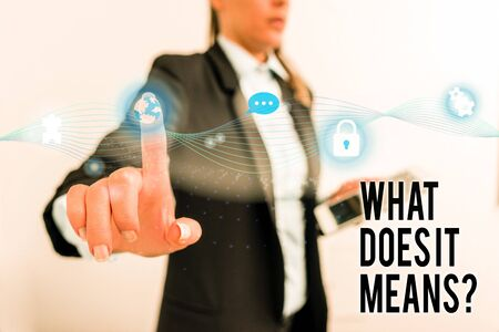 Text sign showing What Does It Means Question. Business photo text asking meaning something said and do not understand Female human wear formal work suit presenting presentation use smart device