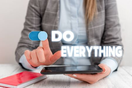 Conceptual hand writing showing Do Everything. Concept meaning Jack of All Trades Self Esteem Ego Pride No Limits Business concept with communication mobile phone Stock Photo