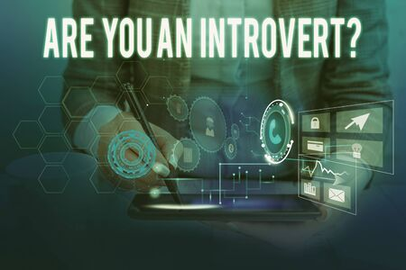 Text sign showing Are You An Introvertquestion. Business photo showcasing demonstrating who tends to turn inward mentally Woman wear formal work suit presenting presentation using smart device