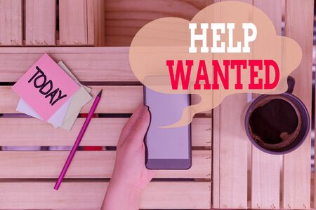 Text sign showing Help Wanted. Business photo text An ad in the paper an employer places to find a new employee woman computer smartphone drink mug office supplies technological devices
