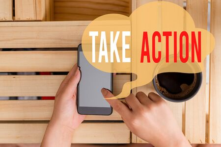 Text sign showing Take Action. Business photo showcasing to do somethingoract in order to get a particular result woman computer smartphone drink mug office supplies technological devices Reklamní fotografie
