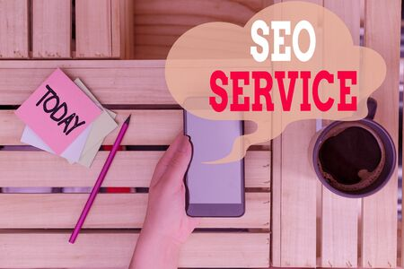 Text sign showing Seo Service. Business photo text techniques and procedures to increase the website visibility woman computer smartphone drink mug office supplies technological devices