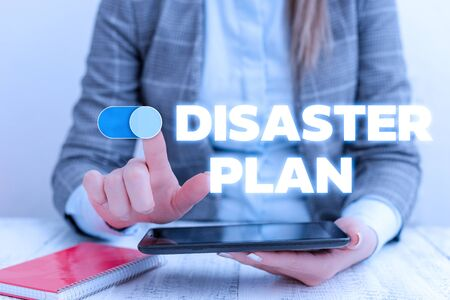 Conceptual hand writing showing Disaster Plan. Concept meaning Respond to Emergency Preparedness Survival and First Aid Kit Business concept with communication mobile phone Stock Photo