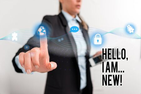 Text sign showing Hello I Am New. Business photo text used greeting or begin telephone conversation Female human wear formal work suit presenting presentation use smart device