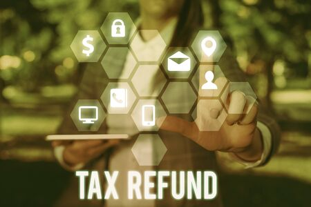 Writing note showing Tax Refund. Business concept for refund on tax when the tax liability is less than the tax paid Stock Photo