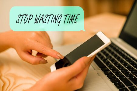 Conceptual hand writing showing Stop Wasting Time. Concept meaning advising demonstrating or group start planning and use it wisely woman with laptop smartphone and office supplies technology Imagens