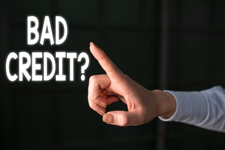 Writing note showing Bad Creditquestion. Business concept for inabilityof a demonstrating to repay a debt on time and in full Finger pointing in the Dark with hand pointing in the copy space