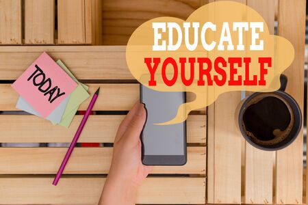 Text sign showing Educate Yourself. Business photo text prepare oneself or someone in a particular area or subject woman computer smartphone drink mug office supplies technological devices Stock Photo - 129656651