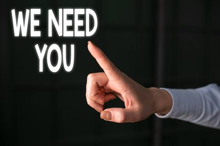 Writing note showing We Need You. Business concept for to fulfill the needs of the assignment duty or obligation Finger pointing in the Dark with hand pointing in the copy space Imagens